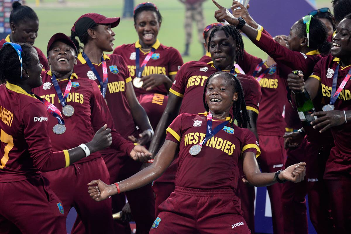 West Indies women's team celebrate the ICC World T20 title last year in India.