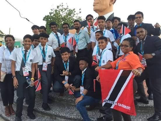 Dr Michael Dowlat, principal of Naparima Boys' College (extreme right with glasses) and the victorious cast members of the Caribbean Drama Festival.