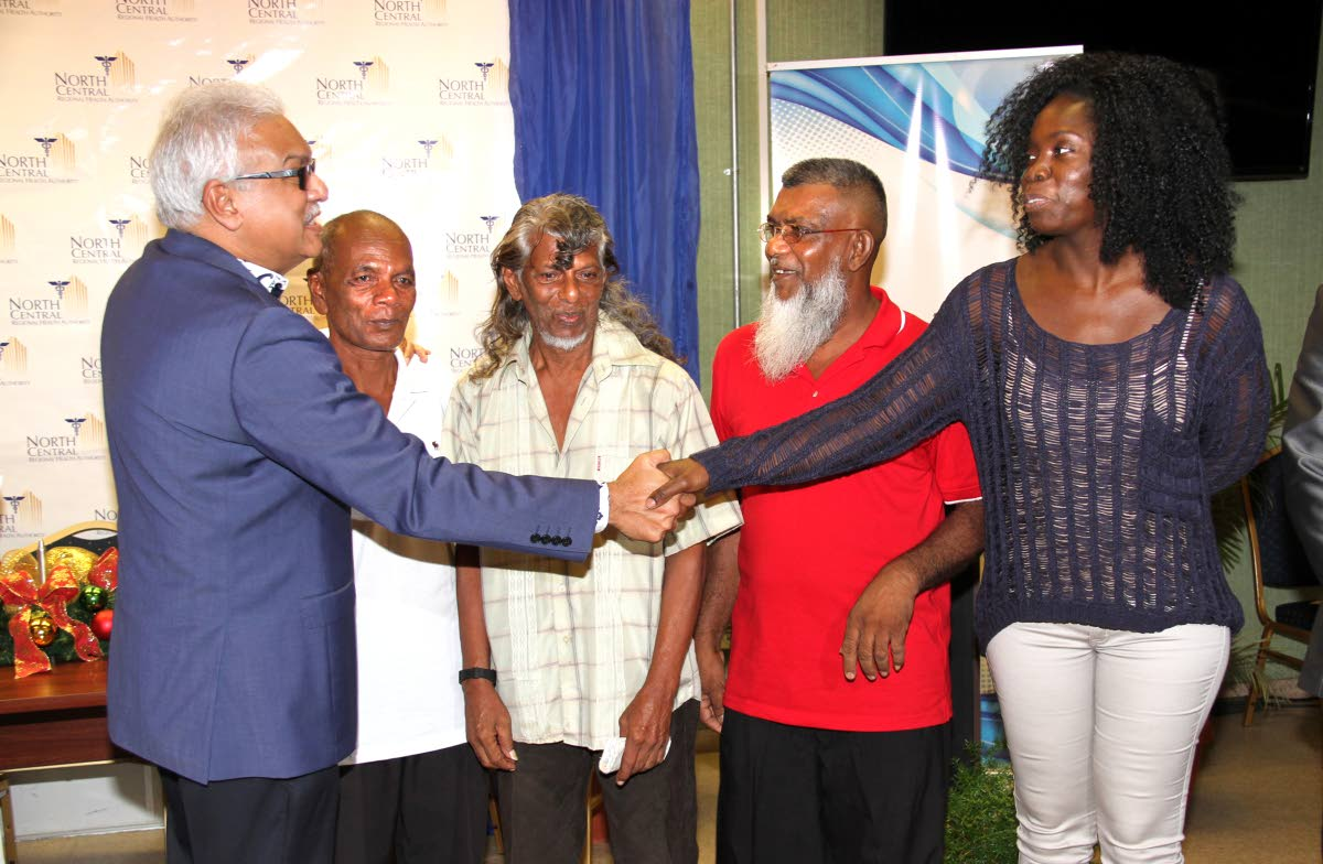 SURGICAL SUNDAYS: Health Minister Terrence Deyalsingh, far left, meets with four of the patients that benefitted from the Sunday surgeries, 2nd from left Roopchan Rampersad, Donald Mohammed, Harrylal Singh and Natalie Dyett. PHOTO BY SUREASH CHOLAI