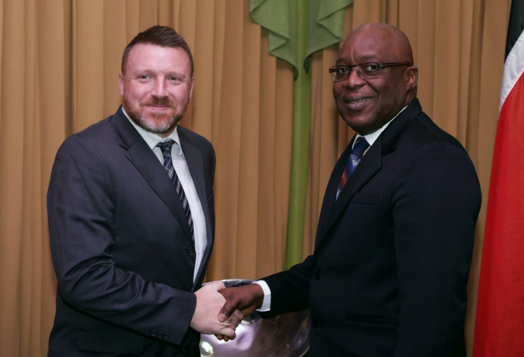THA Chief Secretary Kelvin Charles, right, greets United States Embassy's liaison officer to Tobago, Kevin J Ogley, during a courtesy call at the Administrative Complex, Calder Hall last Thursday.