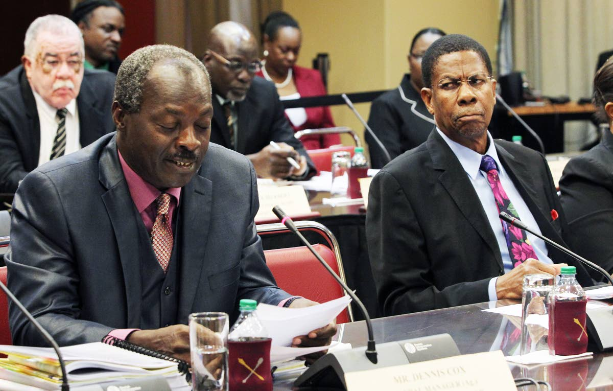 Flashback: Former chairman of the Education Facilities Company Ltd (EFCL) Arnold Piggott, right, looks quizzically at chairman Dennis Cox during the sitting yesterday of the Joint Select Committee at the Parliament Tower, Port of Spain. PHOTO BY RATTAN JADOO.