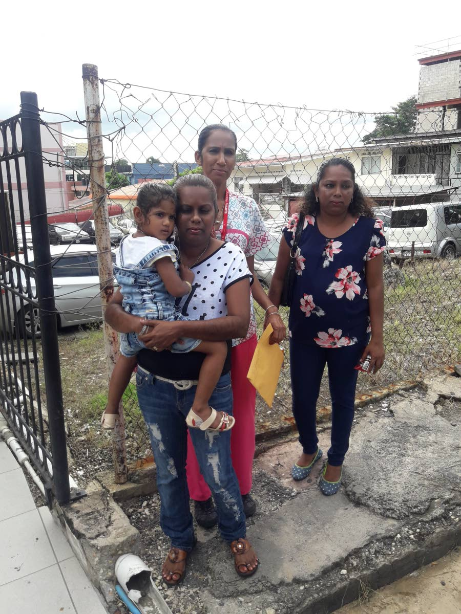 FORGIVING FAMILY: Vijanti Seudath (center)with other members of her family outside the San Fernando Magistrates' court yesterday.