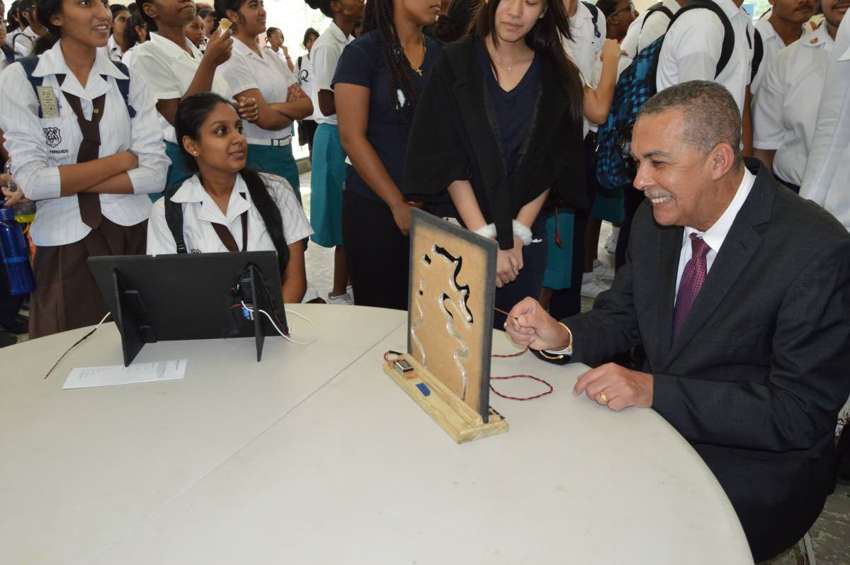 Nerve-racking: President Anthony Carmona tests his nerves at the nerve tester booth at St Joseph's Convent, St Joseph maths fair on December 12. Carmona's term ends on March 18, 2018. Photo by Ana-Lissa Jack