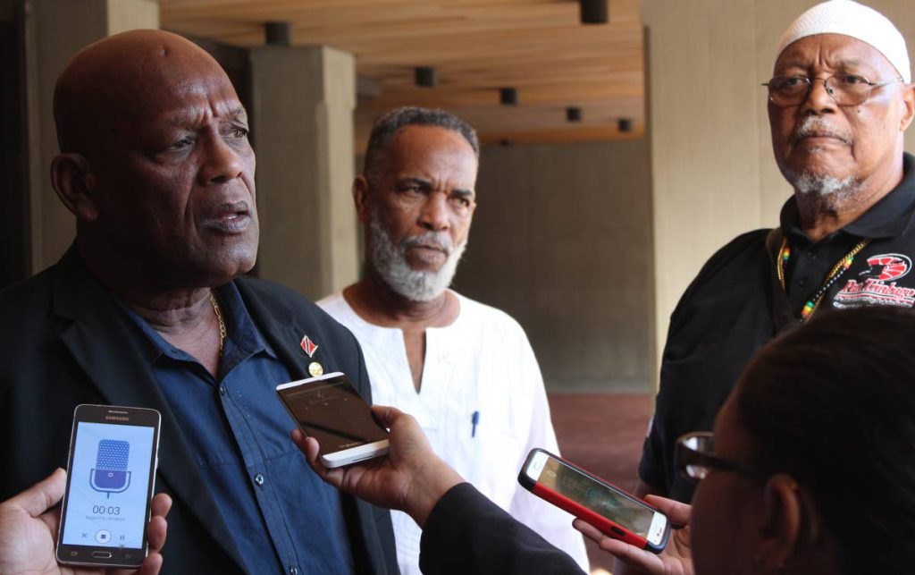 PanTrinbago president Keith Diaz speaks to the media at the Hall of Justice in Port of Spain yesterday along with other members of his executive. PHOTO BY ENRIQUE ASSOON