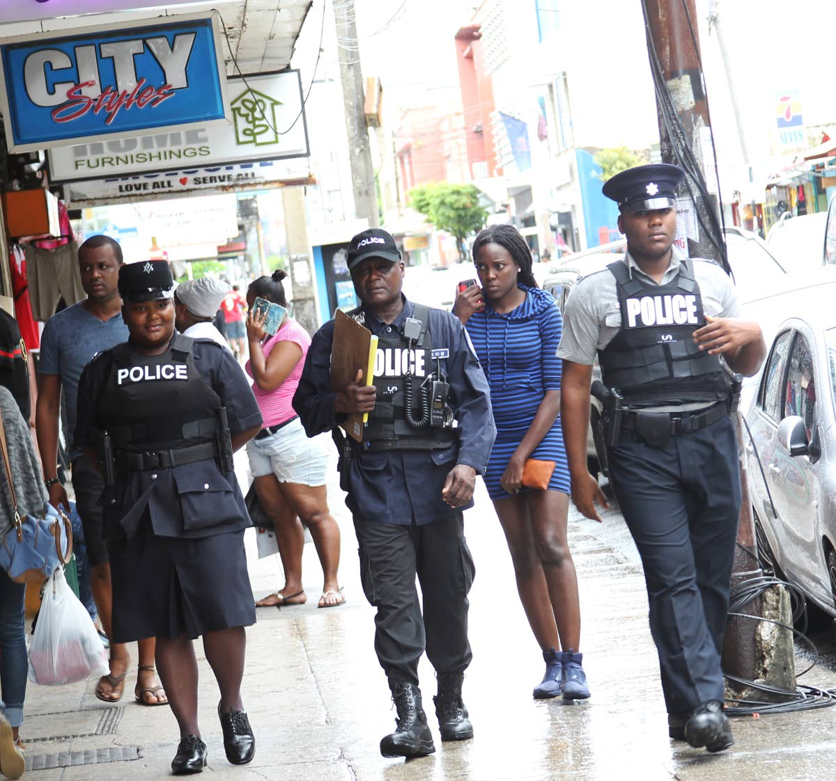 File photo: Police patrol the streets of Port of Spain during the Christmas shopping season. PHOTO BY RATTAN JADOO.