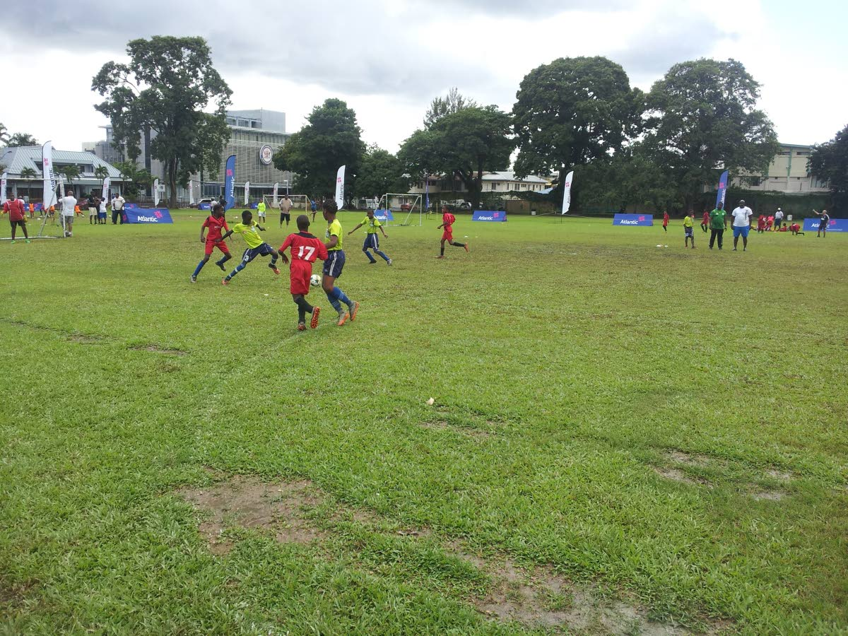 Participants battle in a match during the Atlantic Football Weekend at the Queen's Royal College Ground in St Clair, yesterday.