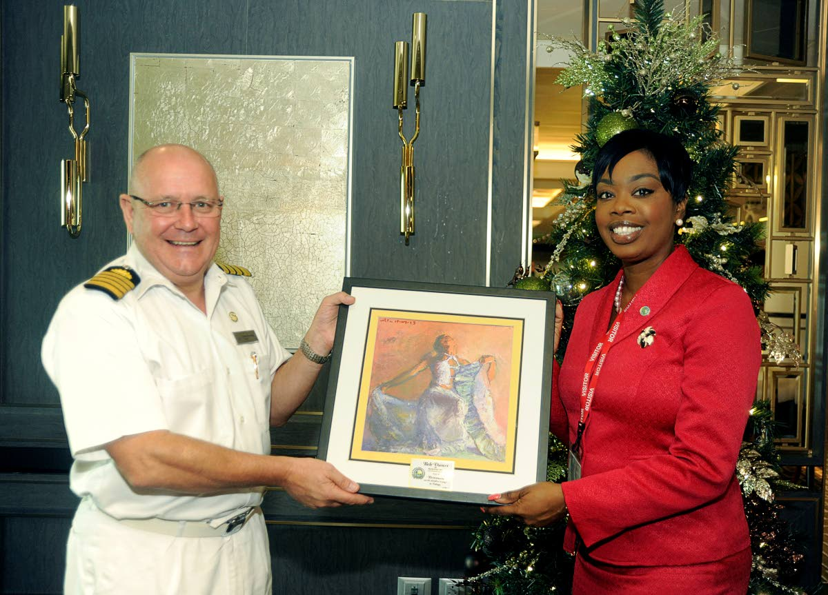 Tourism Secretary Nadine Stewart-Phillips presents MV Britannia's Captain, David Pembridge, with a framed painting entitled 'Bele Dancer,' from local artist, Martin Superville, to mark the occasion of the cruise ship's maiden call to Tobago last Thursday. Captain Pembridge, presented Stewart-Phillips with the official plaque of the vessel