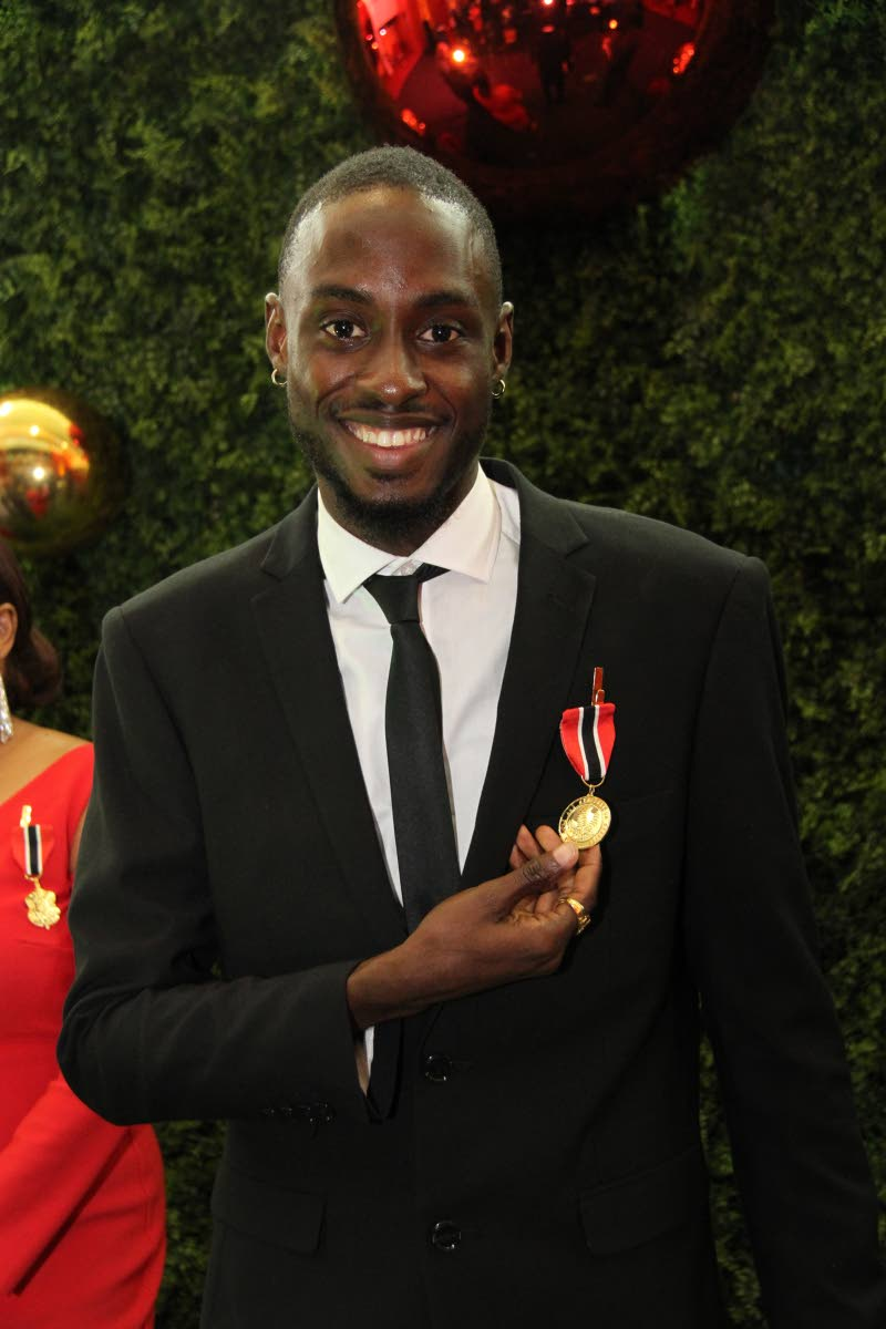 World Championships 4x400m gold medallist, Jereem Richards, shows off his Chaconia Gold medal at the National Awards Ceremony on Monday at Queen's Hall, St Ann's.