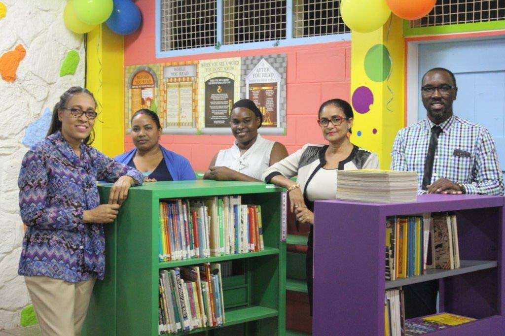 Principal Ann Peters to the left, Mr Toussa int on the right, Giselle Laronde-West and two teachers from the schoo.