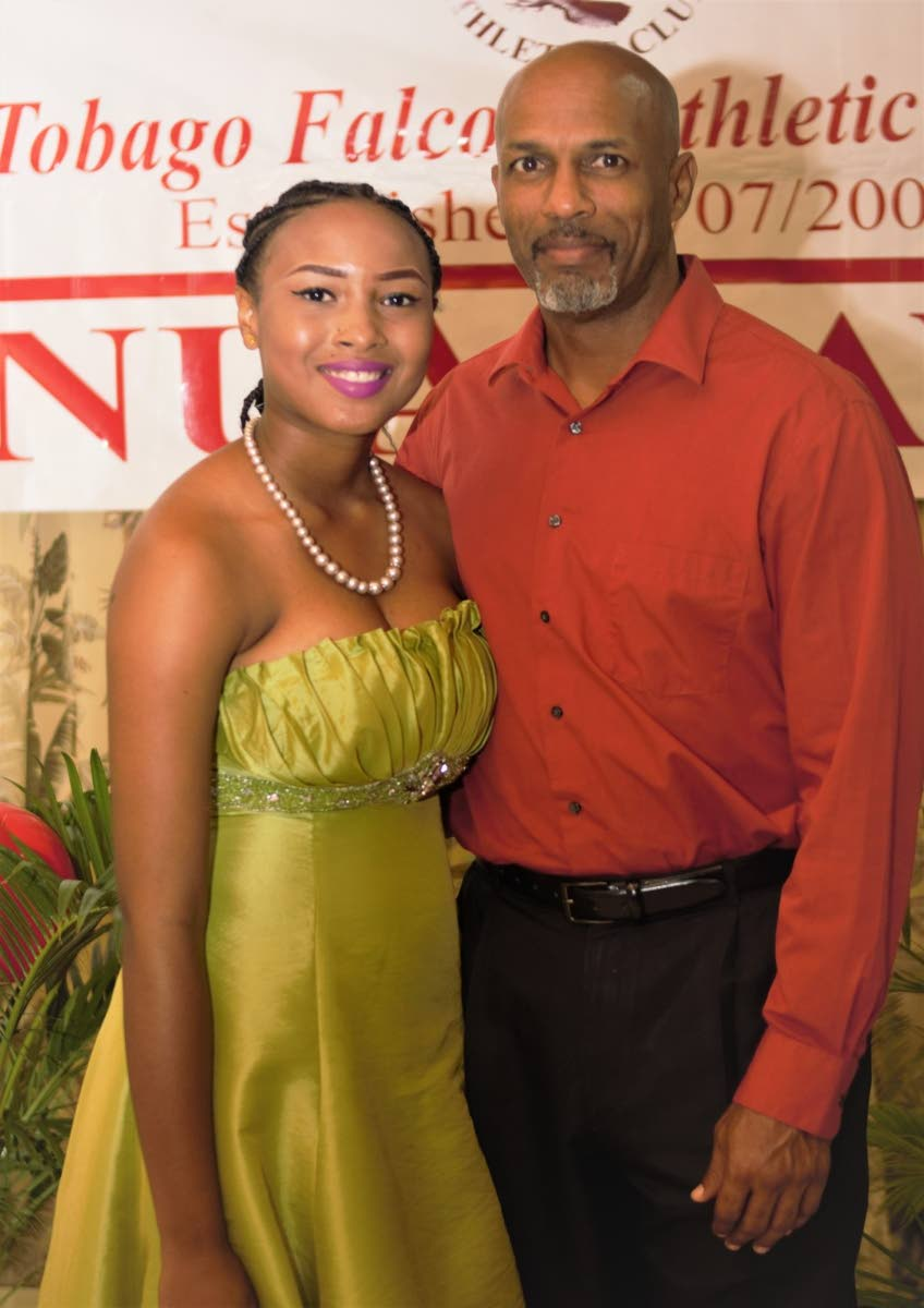 Sports and Youth Affairs Secretary Jomo Pitt poses for a photo with Shakera Kirk, Most Disciplined Athlete, at last Sunday's 18th Tobago Falcons Athletic Club awards ceremony at the Dept of Works conference room, Old Government Farm Road, Shaw Park.