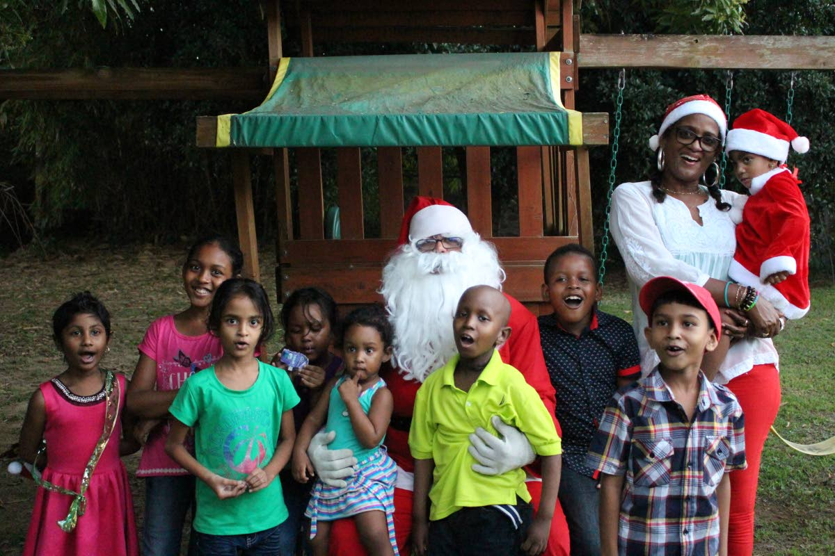 Santa takes a photo op with the JBF kids and founder Chevaughn Joseph.
