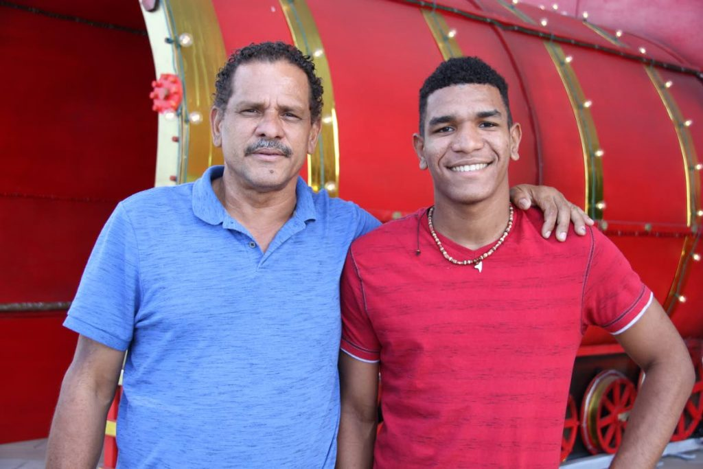 Perfect gift: Martin Lander and his son Brandon, who is studying in Barbados, enjoy an afternoon at Trincity Mall. Lander has been living with his brother in St Joseph since Hurricane Maria destroyed his home in Dominica in September. Photo by SUREASH CHOLAI