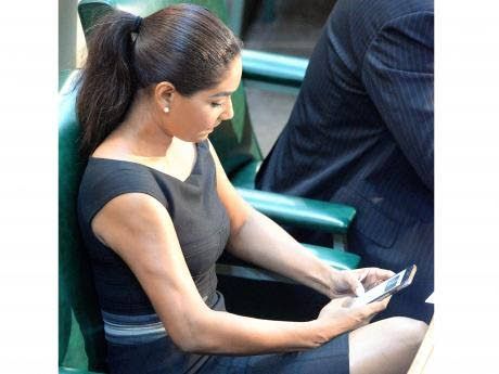 Lisa Hanna on the Opposition benches in her cap sleeve dress. Photo Courtesy: Jamaica Gleaner