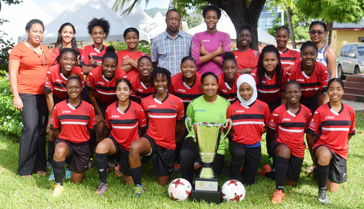TITLE-HOLDERS: Victorious Bishop Anstey High School, Port of Spain, Girls' football team with the Coca-Cola National Girls' Intercol trophy