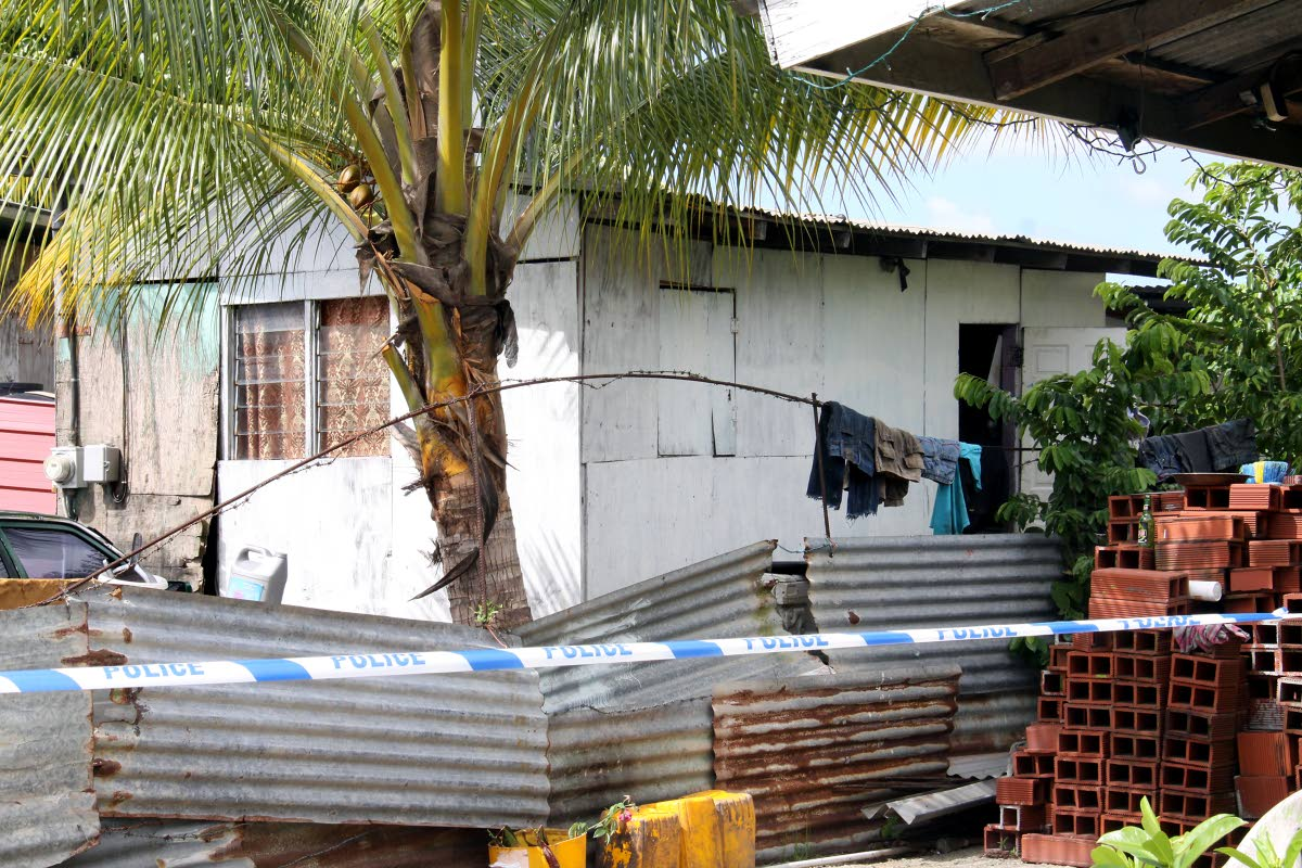 DEATH HOUSE: Gunmen killed Wellington Thomas, his wife Binta James and friend Kiston Guy in Thomas' home at Bridel Road, Jerningham Junction, Cunupia yesterday.  PHOTO BY ANGELO MARCELLE.