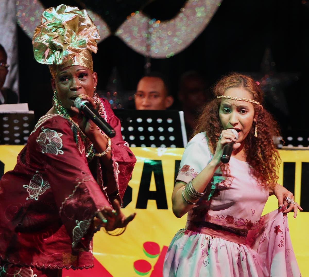 Josanne Rodriguez, left, and Empress Natty (Natalie Joseph Settle) perform Feel like Dancing at the Divas Calypso Cabaret International at Mas Camp Pub, Port of Spain on February 1, 2017.