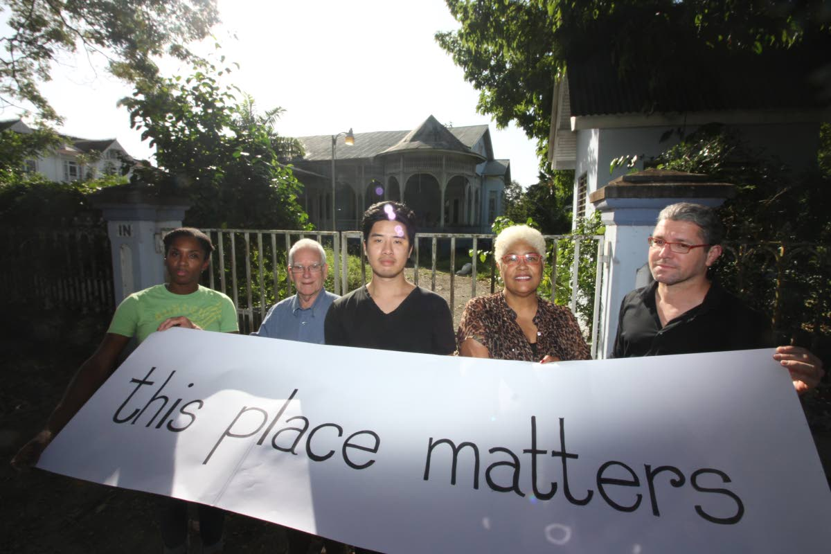 From left,  Abigail Charles, Geoffrey MacLean, Josh Lue Chee Kong, RudyLyn Roberts and Martin Mouttet extend the This Place Matters online campaign outside the former residence of the House Speaker, at 9 Mary Street, St Clair. PHOTO BY ROGER JACOB