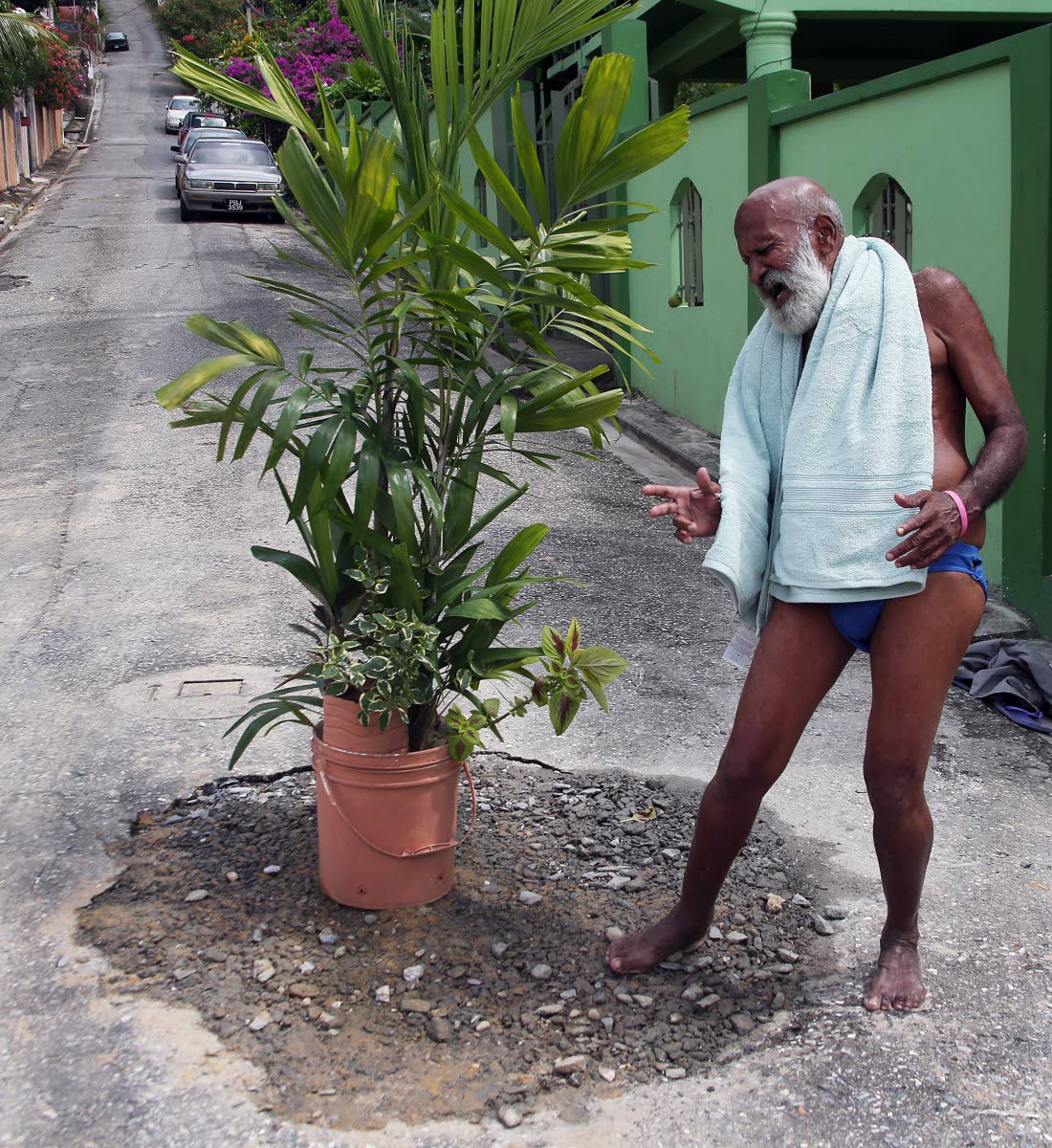 POOL PARTY READY: Ken Sammy says he is ready to get back into the hole if ever the repairs to a broken water main at Cuthbert Street, Diego Martin fails.
