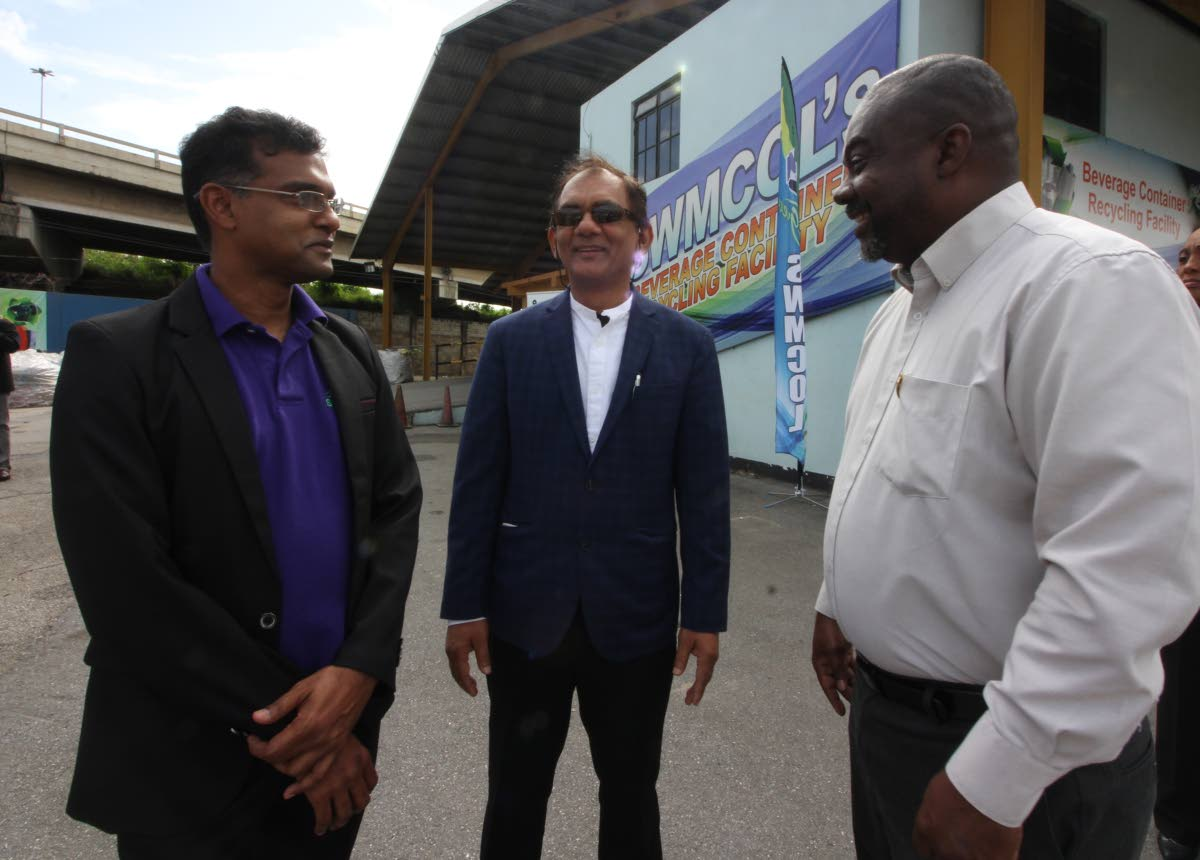 TALKING TRASH: SWMCOL CEO Ronald Road, chairman Shamshad Mohammed and project manager Dale Cozier at yesterday's launch of the new plastic bottle treatment facility.