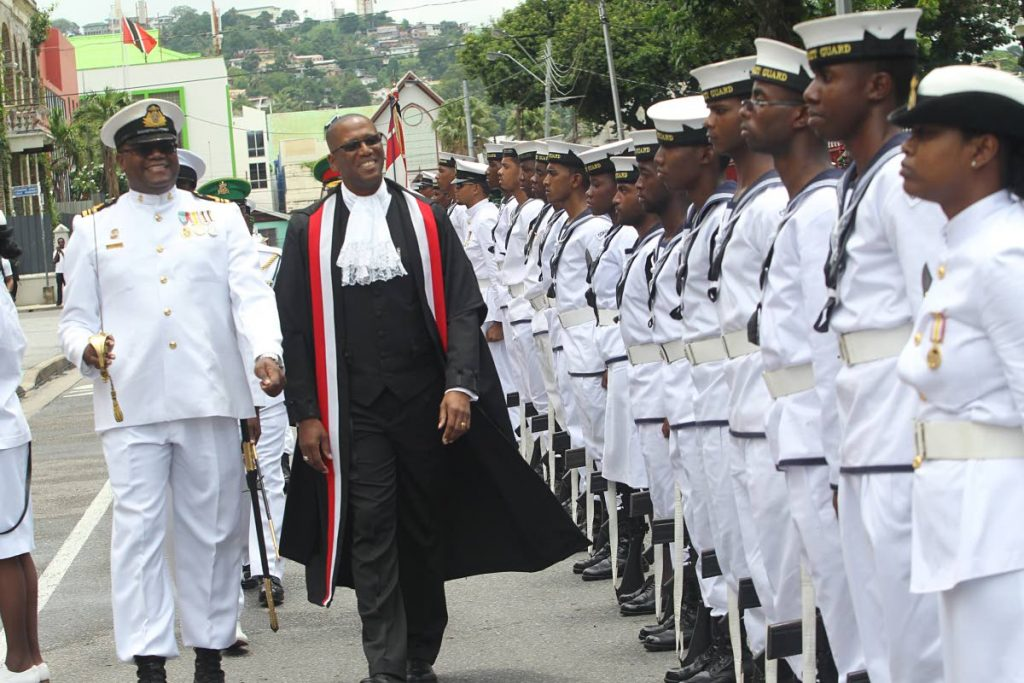 In this September 2014 file photo, Chief Justice Ivor Archie inspects a guard of honour during the opening of the 2015 law term in Port of Spain. Anantics, a US technology firm, has advised Archie that photographs allegedly linking him to convicted felon Dillian Johnson are fake.