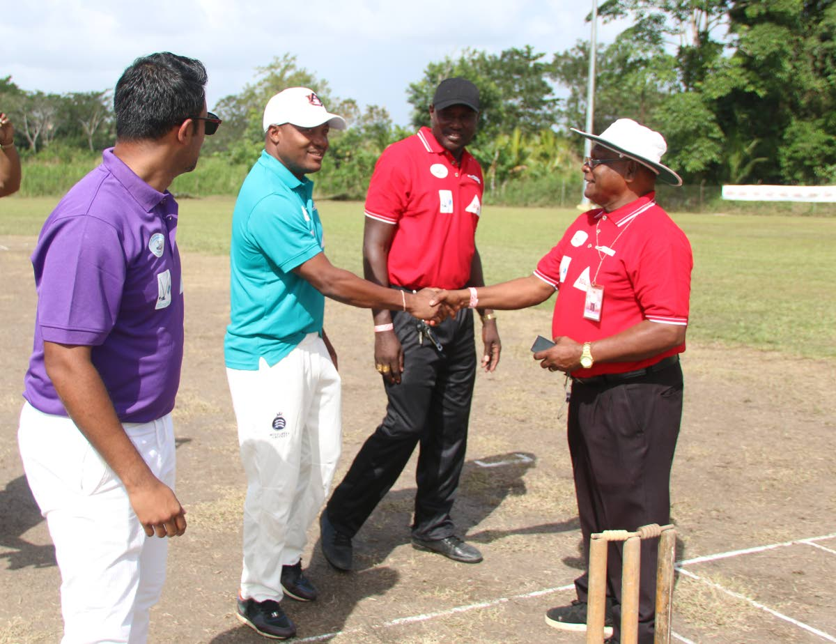 Brian Lara, second from left, shakes the hand of an umpire as Daren Ganga, left, looks on at the start of a T20 charity match on Saturday in Barrackpore.