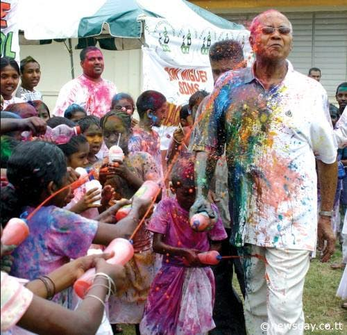 In this photo taken in 2009, then President George Maxwell Richards is sprayed with abeer during Phagwa celebrations at the Tunapuna Hindu School.