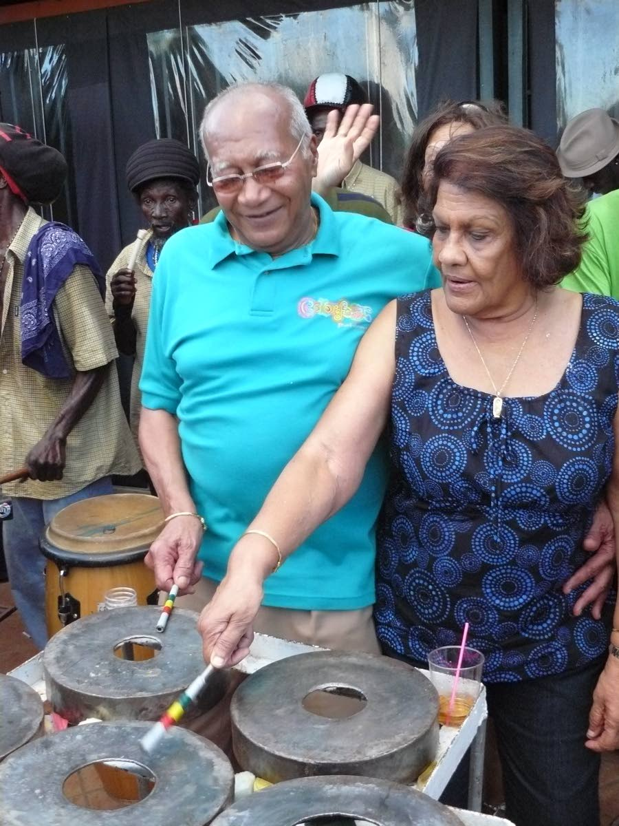 Prof Max and Dr. Jean Ramjohn-Richards try their hands at beating iron