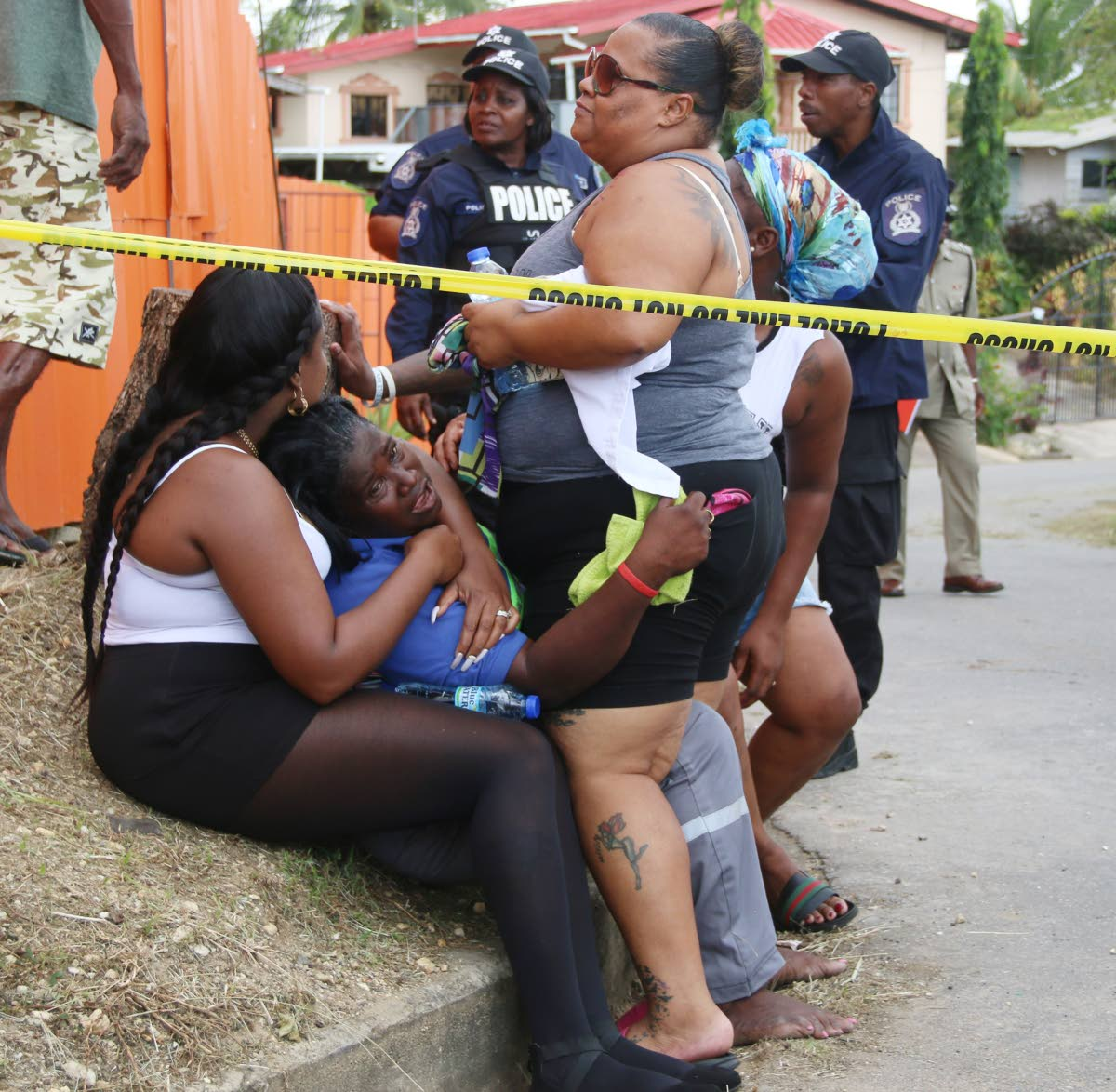 THEY KILLED MY SON: Cleopatra Wilson is inconsolable at the scene where her 30-year-old son Akeemie Wilson and his friend Jahmie Donaldson, 26, were shot dead in Pleasantville yesterday.   PHOTO BY ANSEL JEBODH