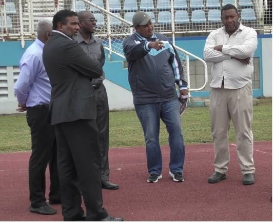 Sports Minister Darryl Smith, second from right, makes a point during a visit to the Ato Boldon Stadium in Couva yesterday. He is joined by TTFA boss David John-Williams, right, Sport Company Chairman Dinanath Ramnarine, left, and other officials.