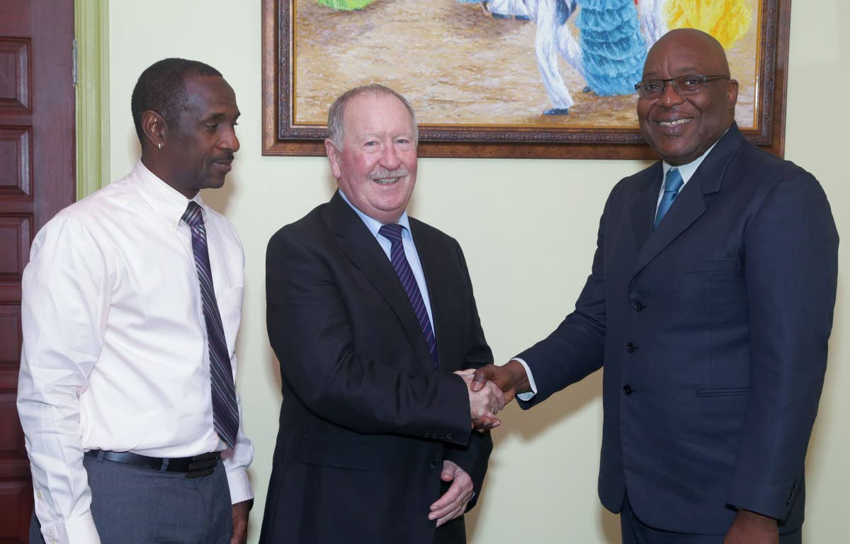 Union of European Football Associations (UEFA) certified British coach Jim Kelman, centre, paid a courtesy call on THA Chief Secretary Kelvin Charles at the Administrative Complex, on Wednesday (January 10).  With them, left, is Department of Sport coach supervisor Peter Granville.