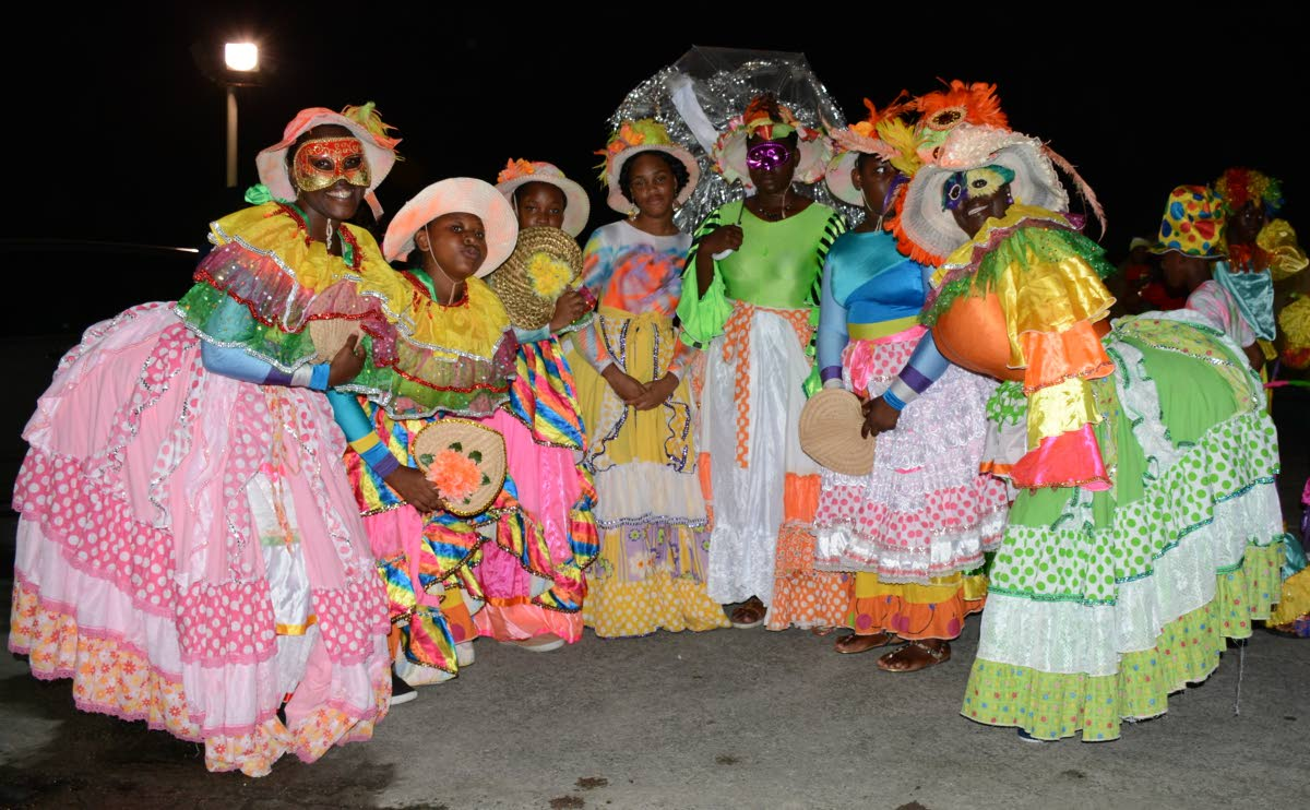A group of Dame Lorraines pose for a photo in Roxborough for Carnival 2017