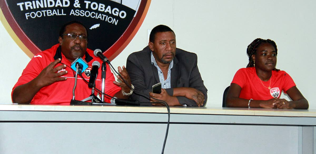 Left to right, Women's Under-20 football coach Jamaal Shabazz addresses the media yesterday along with president of the TTFA David John-Williams and captain, Natisha John during a press conference for the 2018 CONCACAF Women's Under-20 Championships and  a training session at the Ato Boldon Stadium, Couva.