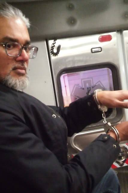 TT-born immigration rights leader and executive director of the New Sanctuary Coalition of New York City, Ravi Ragbir, in handcuffs after being detained by ICE officers in NYC during a scheduled check-in on January. PHOTO COURTESY AMY GOTTLIEB.