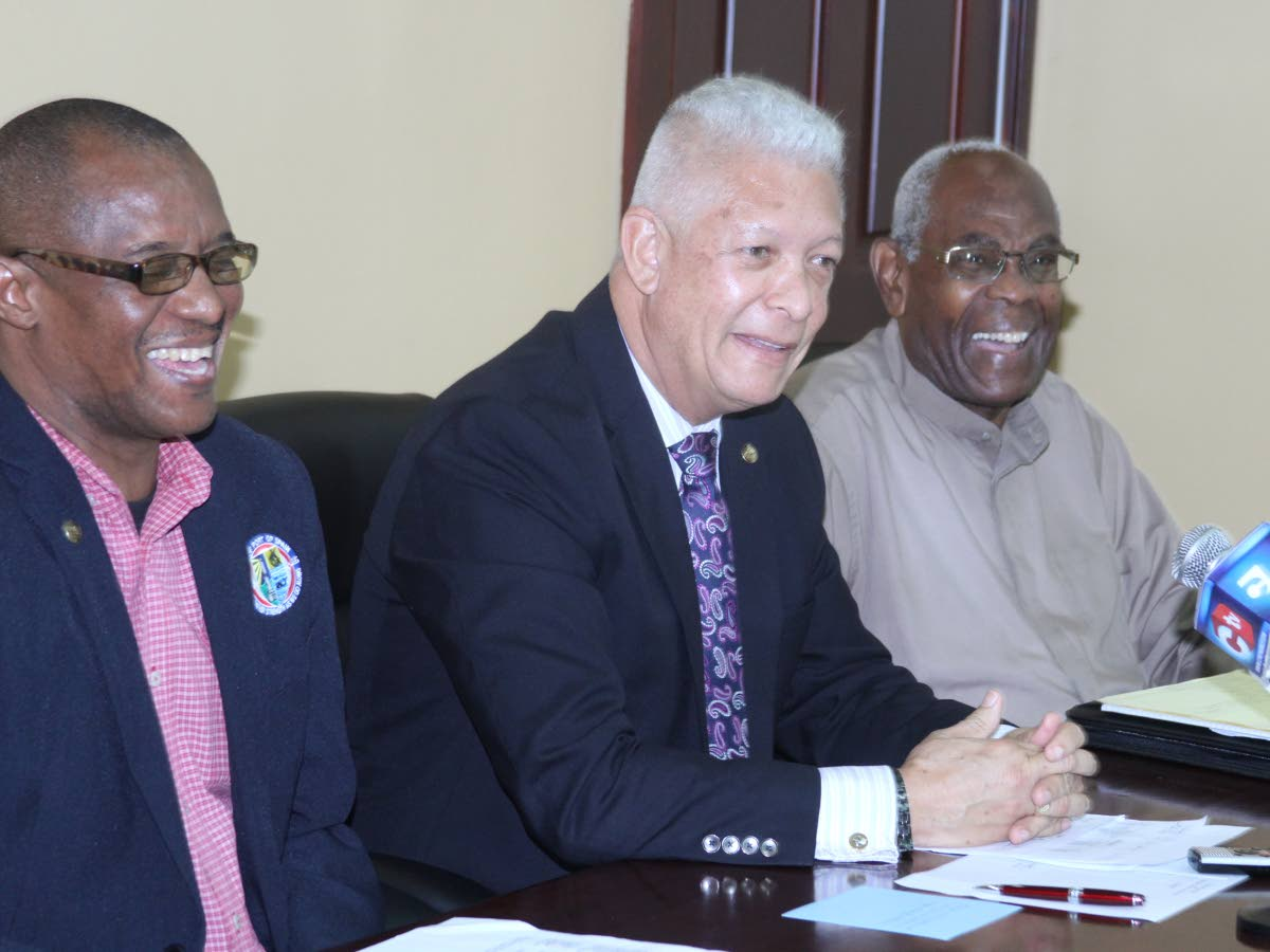 Port of Spain Mayor Joel Martinez, centre, flanked by former mayor Murchison Brown, right, and Alderman Wendell Stephen on Tuesday at a press conference. PHOTO BY ROGER JACOB