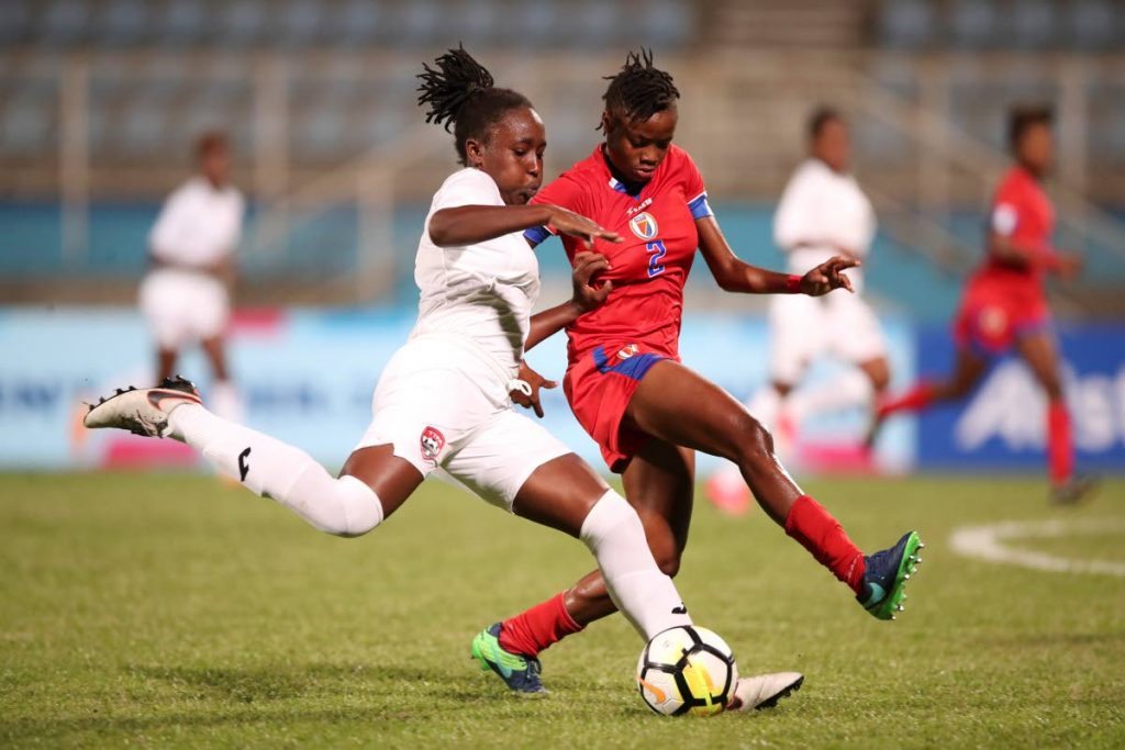TT striker Denneica Prince blasts a shot at goal to score the first goal in the TT vs Haiti CONCACAF U20 Women's Championships match at the Ato Boldon Stadium yesterday. Haiti won 3-2.