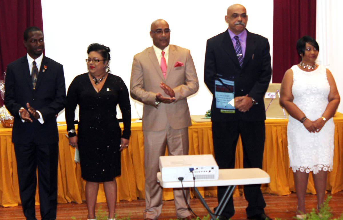 left to right are the finalists of the frank b seepersad memorial teacher of the year award , adriel benjamin , nadia carleen khan-forte  , shiva gerard harry , ephraim ramkissoon , fay-ann ryan on Thursday evening at the bureau of standards building , macoya  photo by enrique assoon  1-19-18