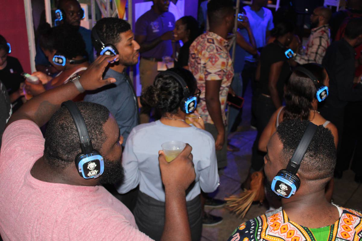Silent party: Island People revellers dance to music on their headphones in a silent part at the promoter's headquarters on Tragerete Road, Port of Spain on Friday night. Photo by Enrique Assoon.