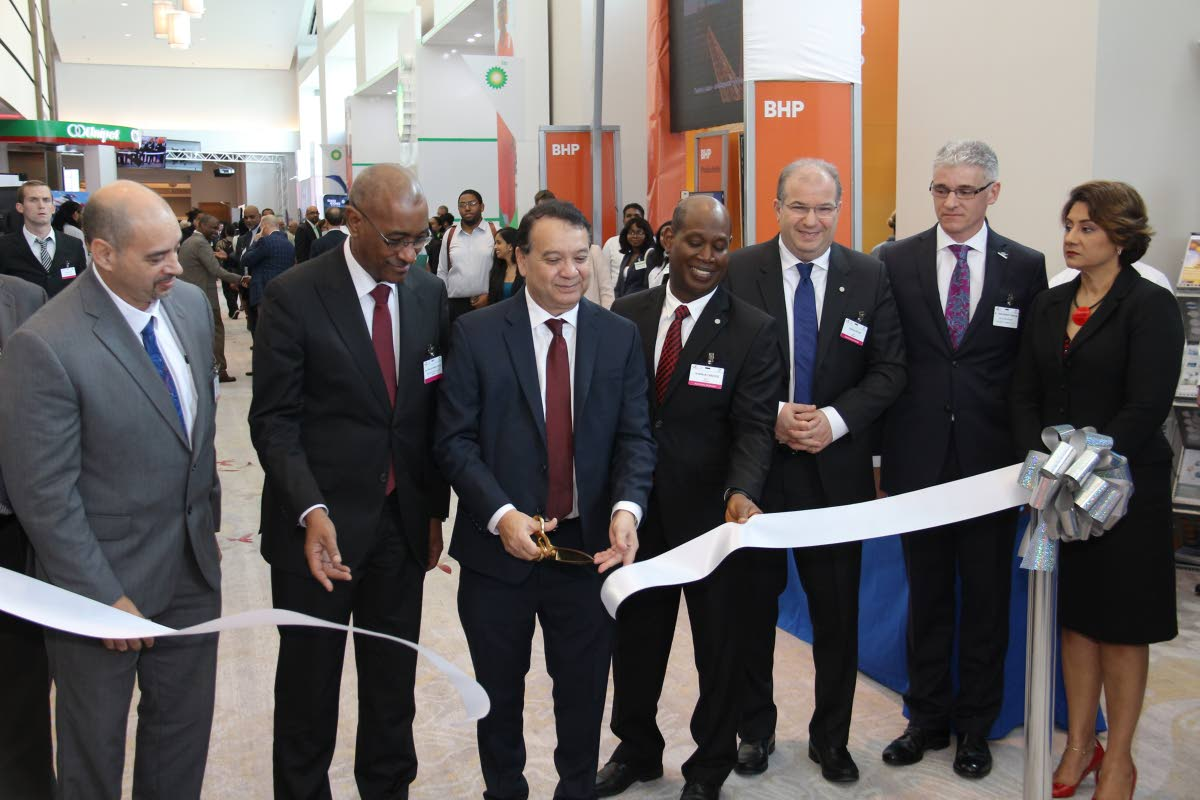 Energy Chamber chairman Eugene Tiah, Public Utilities Minister Robert Le Hunte, Energy Minister Franklin Khan, Norman Christie  regional president, BPTT, head of Global Operations Upstream BP Fawaz Bitar, Dr Thackwray Driver president & CEO Energy Chamber and Karen Darbasie Group CEO FCB cut the ribbon on day one of the 2018 Energy Conference at Hyatt yesterday.