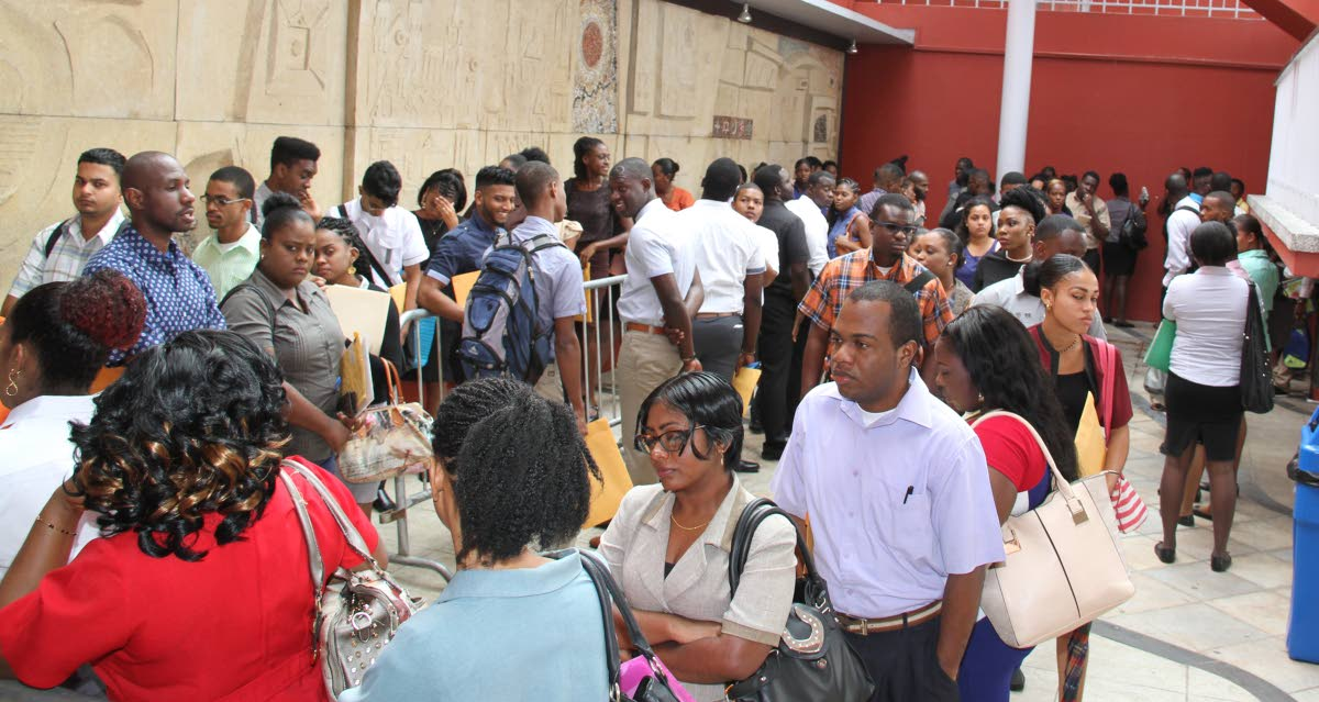Hundreds of people showed up at the Port of Spain City Corporation on Knox Street  to apply to be municipal police officers. PHOTO SUREASH CHOLAI
