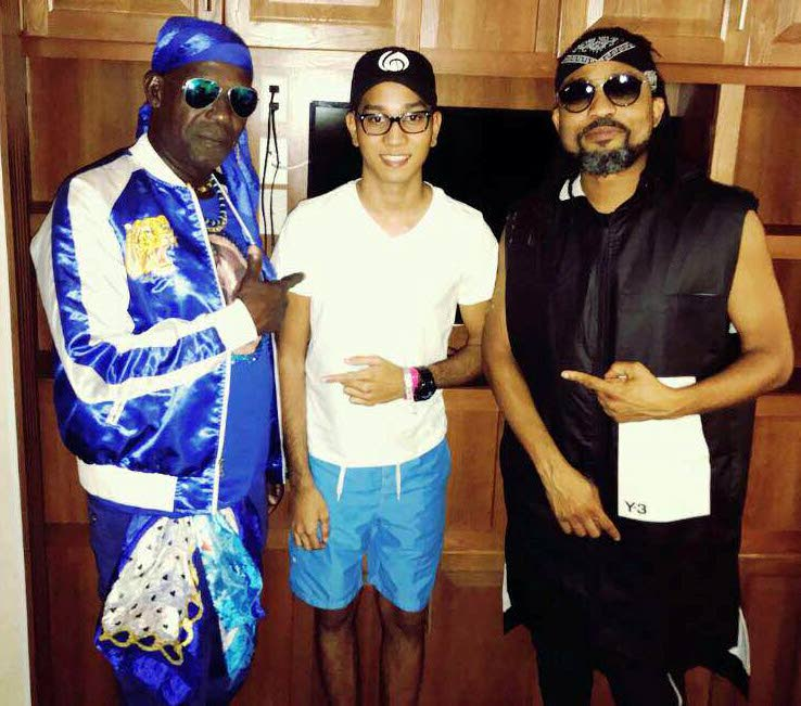 SuperBlue, left, Travis Hosein who is also known as Travis World in the music industry, and Machel Montano.