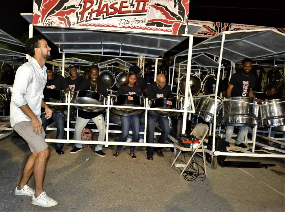 Kees Dieffenthaller dances with Phase II at the band's Hamilton Street, Woodbrook base during judging of Large Conventional bands in the North Zone on Monday.