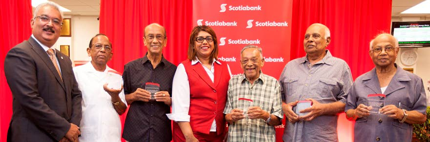 LOYAL CLIENTS: Savon Persad, Scotiabank's Vice President, Retail Banking & Smal Business, left, and Scotia's Sangre Grande branch manager Laura Maharaj-Ramnarine, centre, with the bank's special awardees, from 2nd left, Dennis Williams, Toolsie Mootelal, Evans Gajadhar, Krishna Bissram and Franklin Boodansingh, at an awards ceremony at the bank on Thursday.