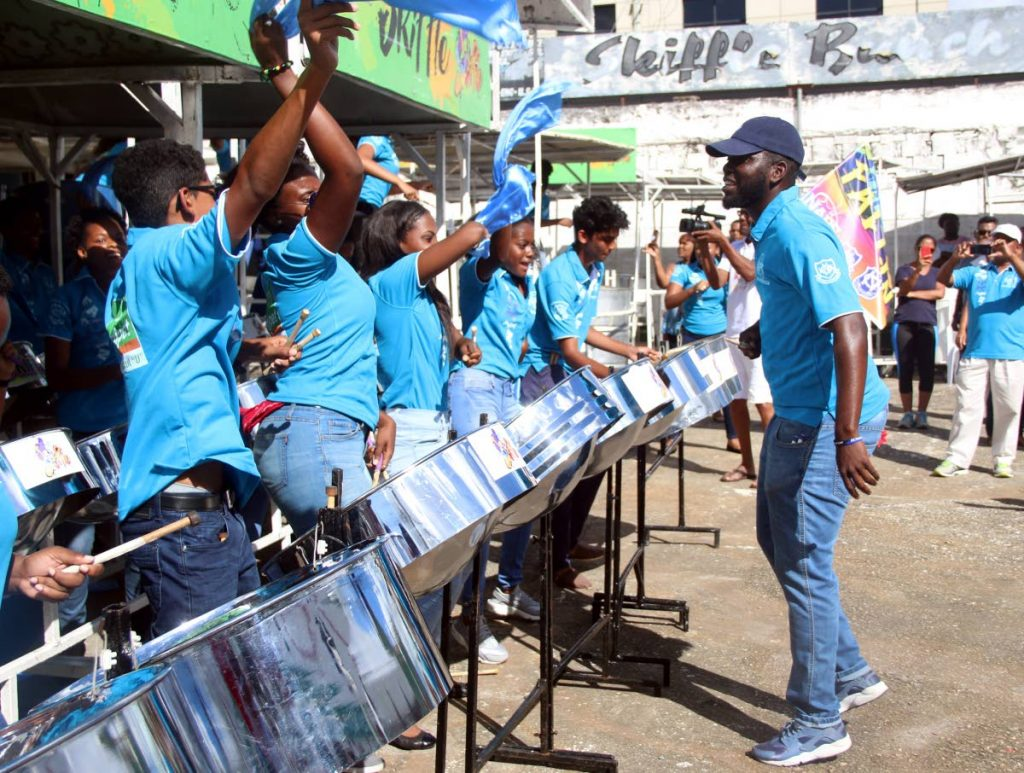 The Naparima Combined Steel Orchestra performing Kees Dieffenthaller's Falling at Skiffle panyard on Coffee Street in San Fernando on Friday, during the judging of schools panorama. The band is comprised of students from Naparima Girls' High School and Naparima College.