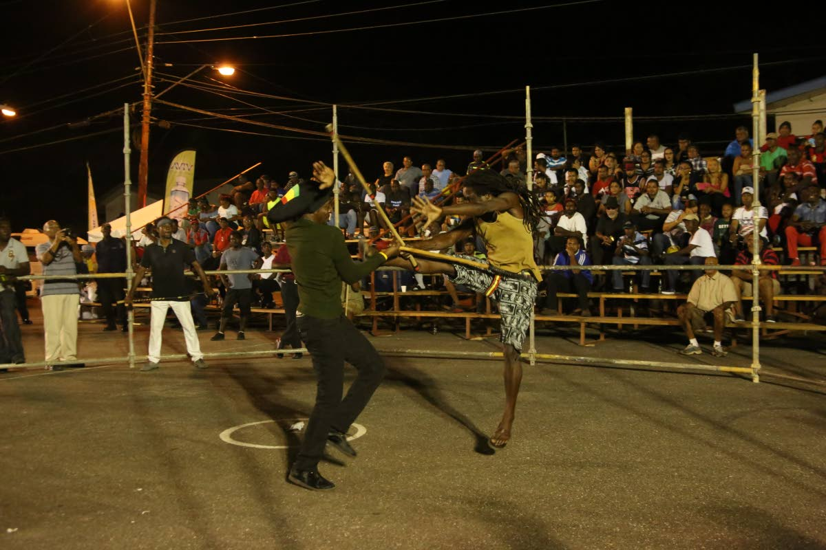 Stickfighters put on an exhibition match after National Carnival Commission judges left the National Stick Fighting Competition at the St Mary's Basketball Court in Moruga on Friday night.