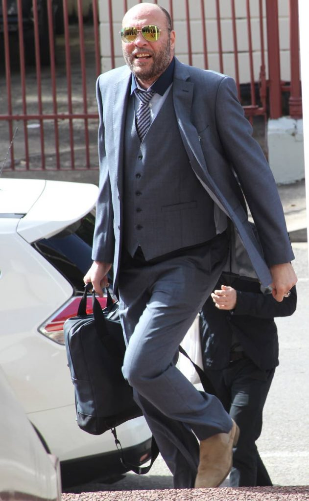 OFF TO COURT: Jason Jones, who is challenging this country's  buggery laws, makes his way to the Hall of Justice in Port of Spain yesterday.   PHOTO BY RATTAN JADOO