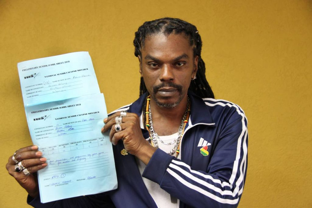 AH VEX: Calypsonian Bro Musa displays his score sheets which he admitted to snatching from the TUCO office and running away. PHOTO BY SUREASH CHOLAI.