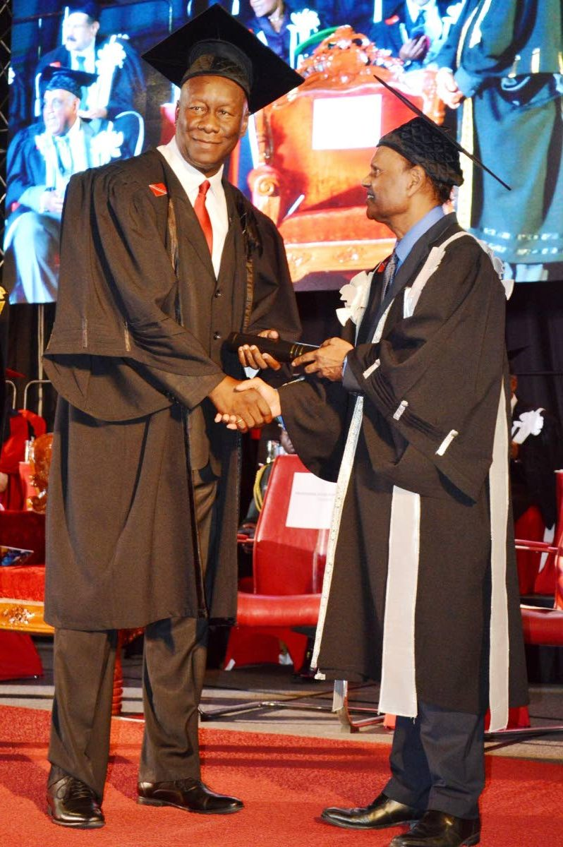 UTT's president Professor Dyer Narinesingh presents Rudolph Ottley with his doctorate.