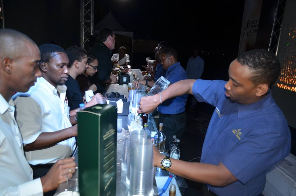 Patrons being served by one of the bars.