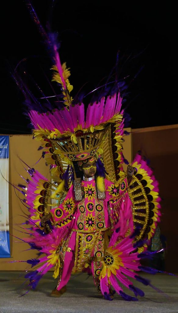 This fancy small Indian masquerader shows off his coustume at The St James Social and Cultural Committee's traditional mas parade at the St James Amphitheatre, Western Main Road, St James on Wednesday.