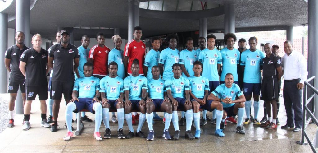 Players and technical staff of Central FC pose for a team photo yesterday, at the Marvin Lee Stadium, Macoya, for the unveiling of the squad that is heading to the Dominican Republic tomorrow to compete in the CONCACAF Caribbean Club Championships which starts on February 7.
